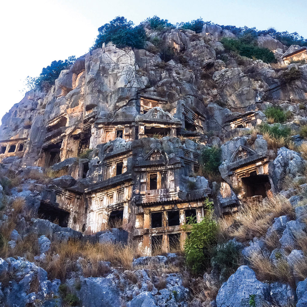The majestic Lycian tombs carved into rocks on the mountainside.